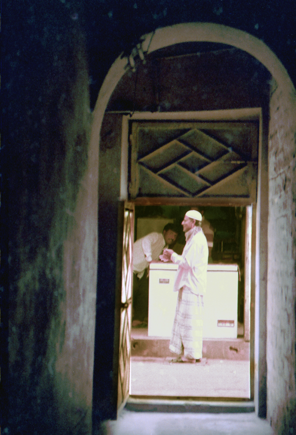 House entrance overlookinng a refrigeration shop. Old Town Dhaka 1991