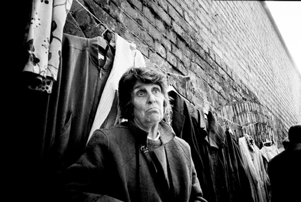 An 'alternative' shop keeper promotes her stock at the Bishopsgate Goods Yard. London 1998.