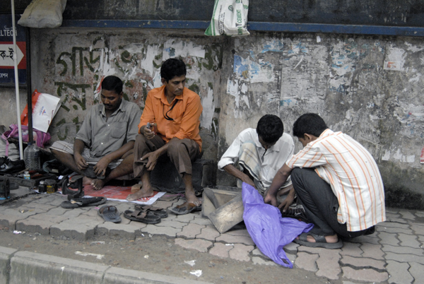 Cobblers hard at work on the pavement in Dhaka. Bangladesh 2009