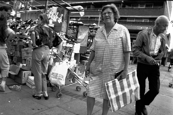 Lady shopping in Watney market. London 1984
