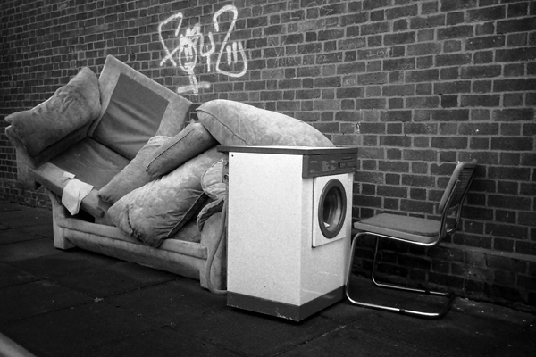 Dumped rubbish on Bethnal Green Road. London 2001