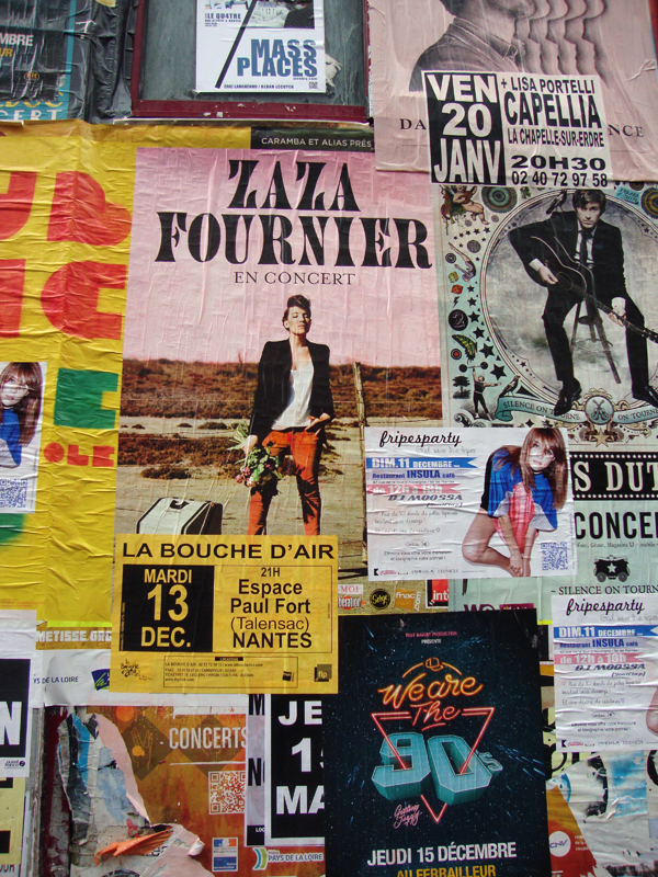 Posters on closed shop front, Nantes, France 2011