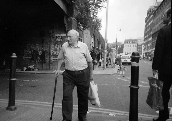 Man with walking stick. Spitalfields 1997