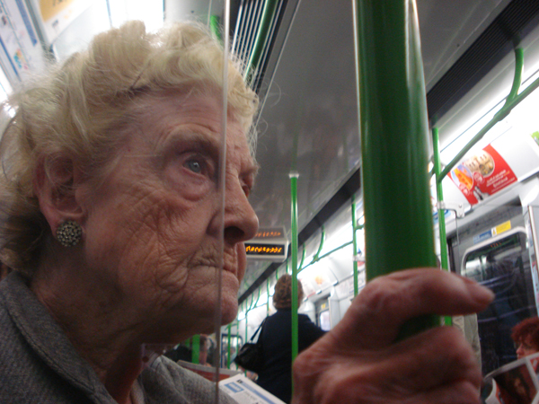 Lady on the District Line. East London 2007