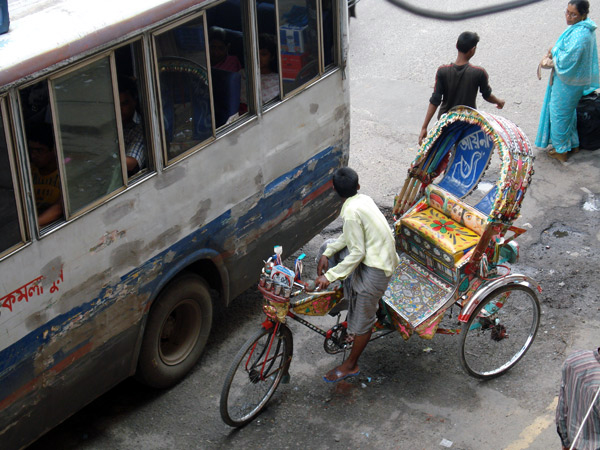Rickshaw and bus. Dhaka, Bangladesh 2009