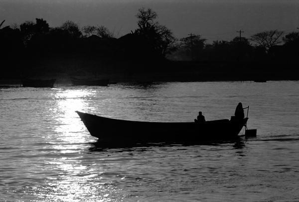 Boat on a river it twilight. Bangladesh 1996