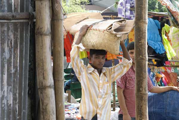 Man with head luggage. Chittagong, Bangladesh 2010