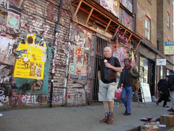Man with Ice Cream. Sclater Street, London 2012