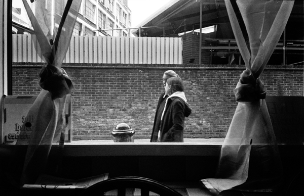 Hanbury Street through the window of Rossi's Cafe. London 1998