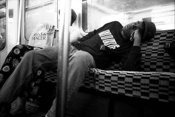 Man sleeping on the underground. London 1993