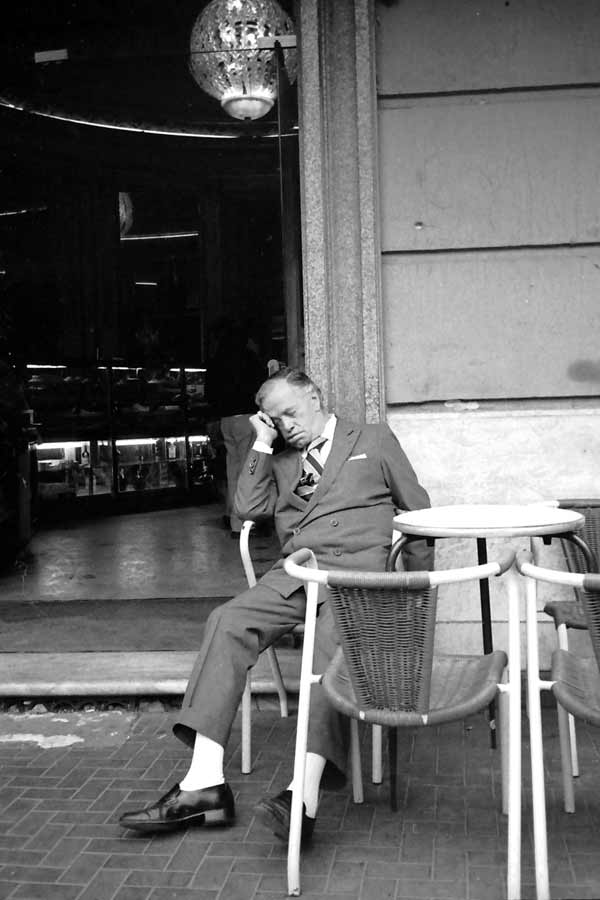 Man sleeping outside restaurant. Naples 1989