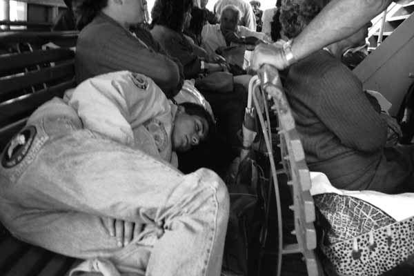 Young man sleeping on a ferry boat. Naples 1989