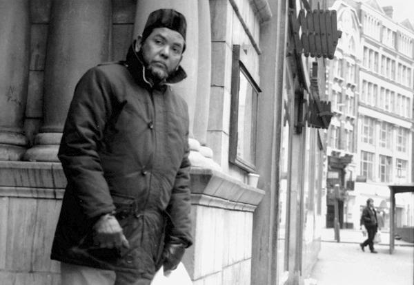 Man outside the Bishopsgate Institute. London 1989