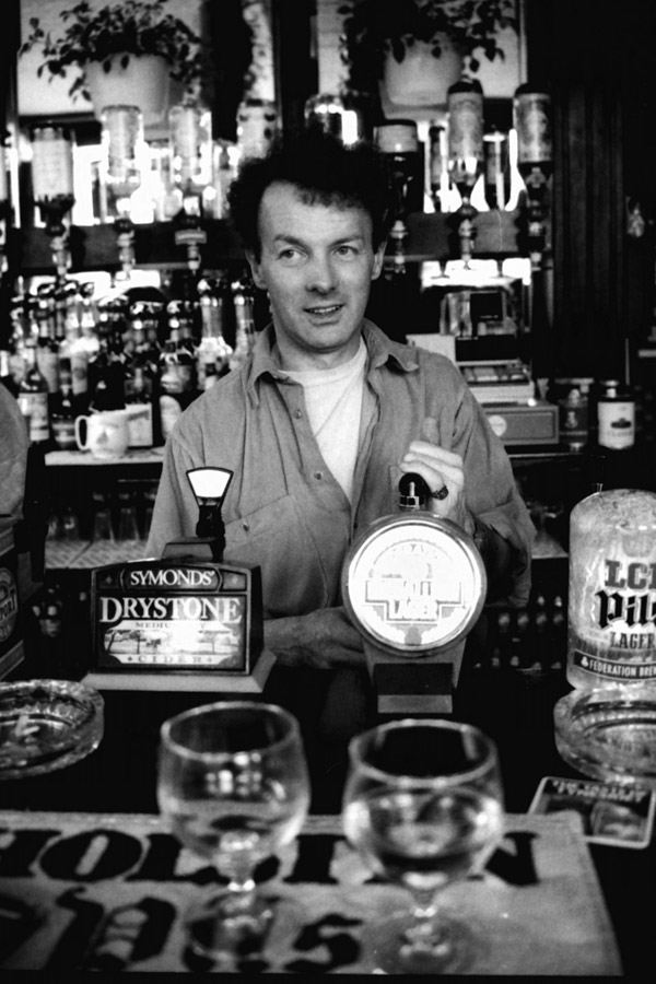 Vincent Hayes behind the bar at the Lord Hood pub. London 1980's