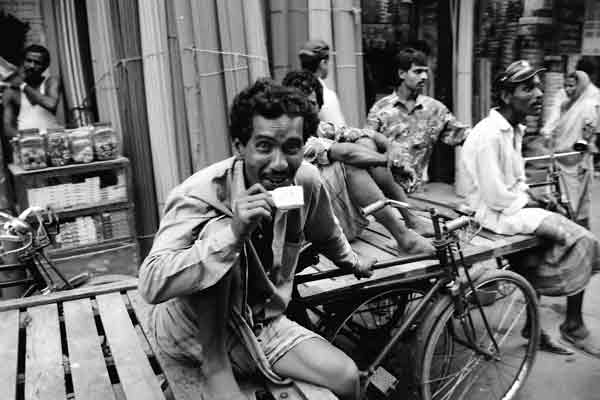 Man with cup of tea in the street. Dhaka, Bangladesh 1990