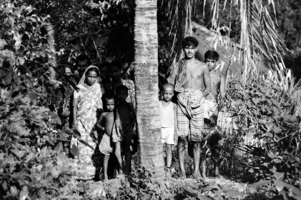 Trees with people in a village outside Dhaka. Bangladesh 1996