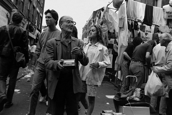 Man selling cassette tapes. Sclater Street, London 1985