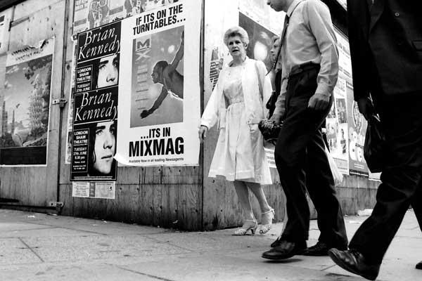 Pedectrians in Aldgate pass a building site. London 1987
