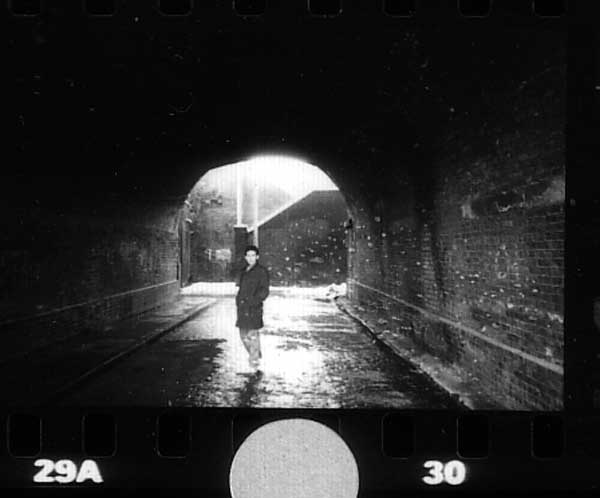 Man under a bridge. Fleet Street Hill, London 1982