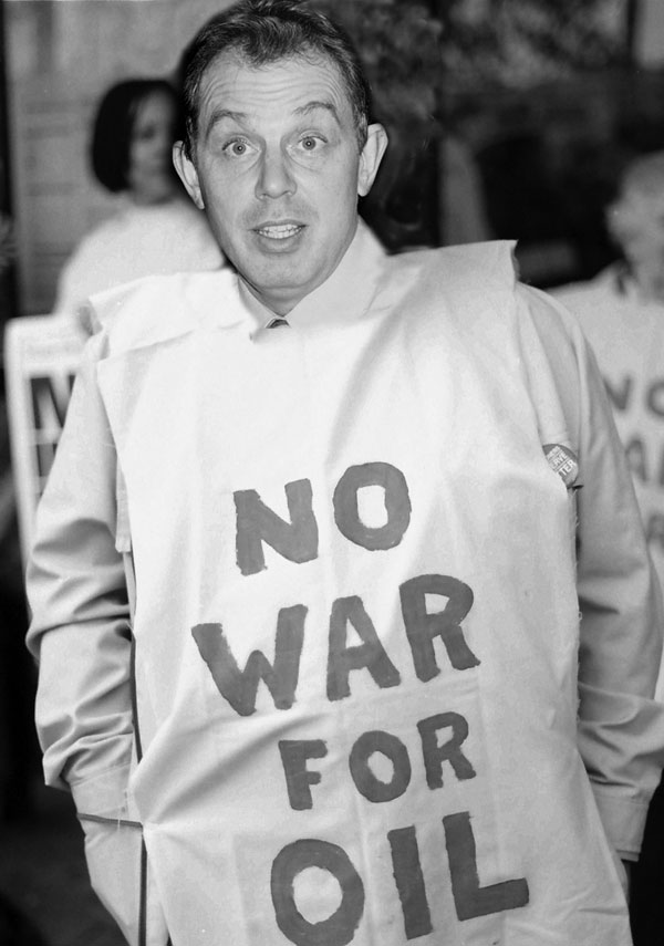 Photomontage with a message and Tony Blair. Demonstration against the war, London 2003