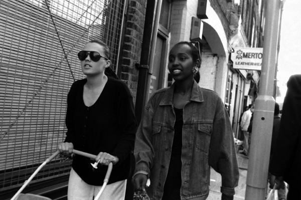 Two women walking down Brick Lane, London c.1985