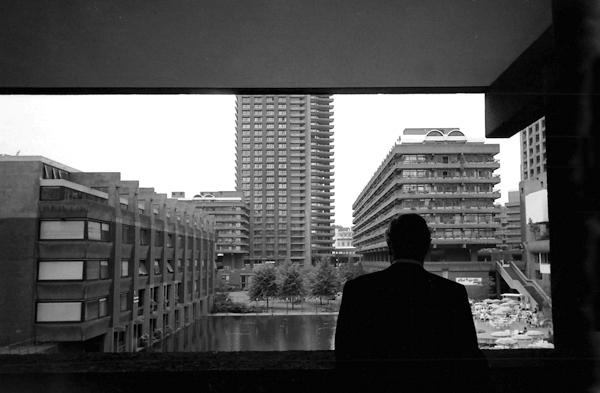 Man contemplates the Barbican Estate, London c.1988