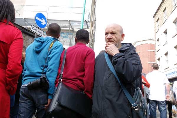 Man on a contemplative walk, Brick Lane 2012