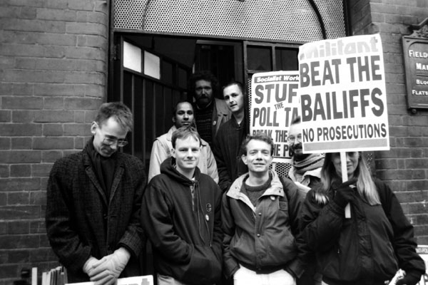 Campaigners outside the home of Horif Miah who was threatened with bailiffs. East London 1991