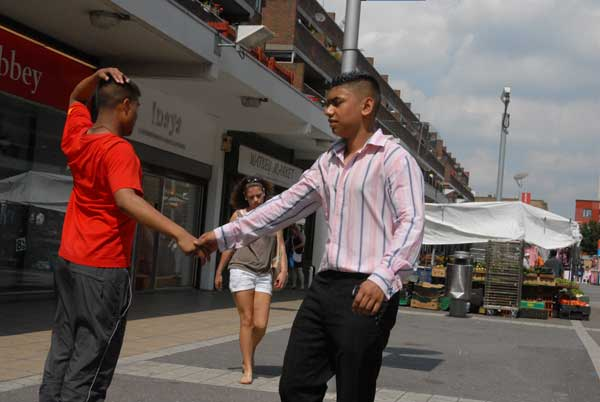 Shaking hands. Watney Market, London 2009