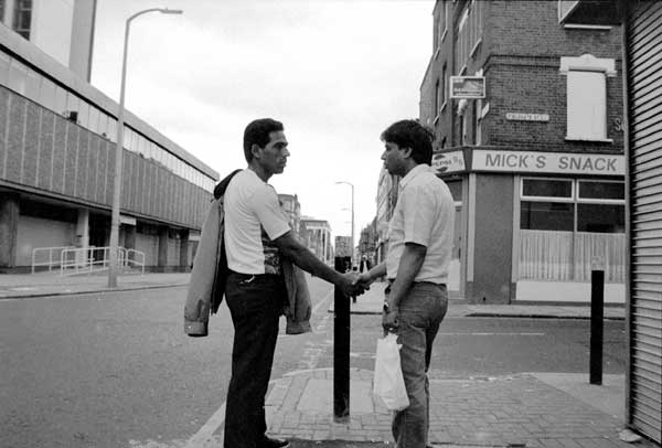Shaking hands. New Road, Whitechapel London c.1985