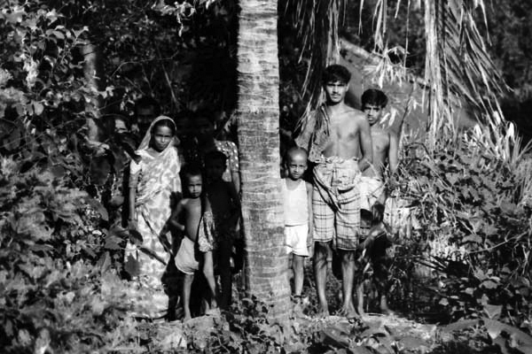 Villagers in the trees outside of Dhaka, Bangladesh C.1992