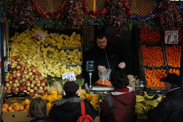 Man serving on fruit stall, Budapest 2010