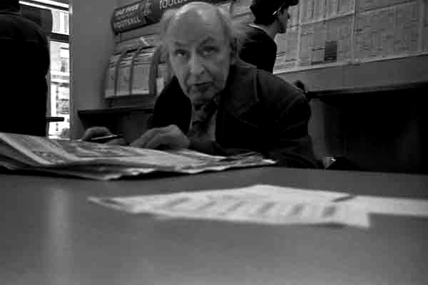 Man in betting shop, Whitechapel c.2001