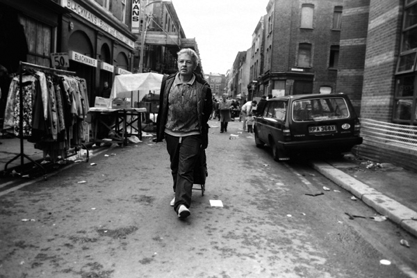 Woman pulling shopping trolley in Cheshire Street, c.1985