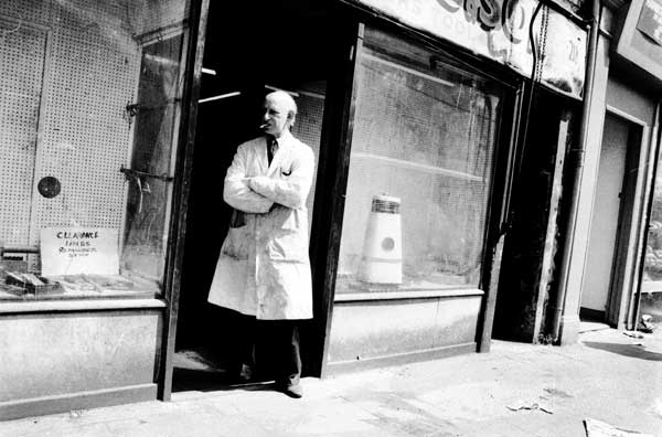 Shopkeeper on Brick Lane, London c.1984