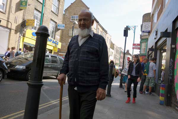 Man with walking stick. Brick Lane, London 2012