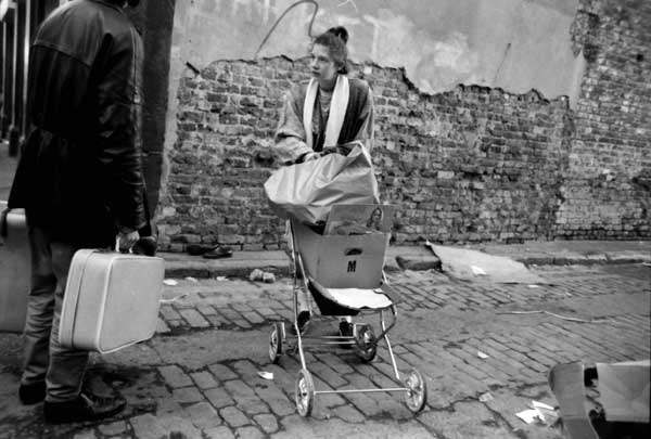 Woman with push chair and boxes, Grimbsy Street c. 1990