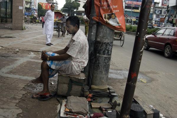 Cobbler waiting for custom, Dhaka Bangladesh 2009