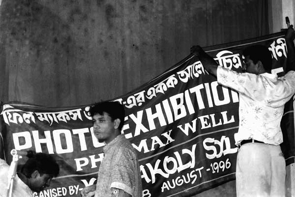 Positioning a banner advertising the Exhibition 'East', Bangladesh 1996