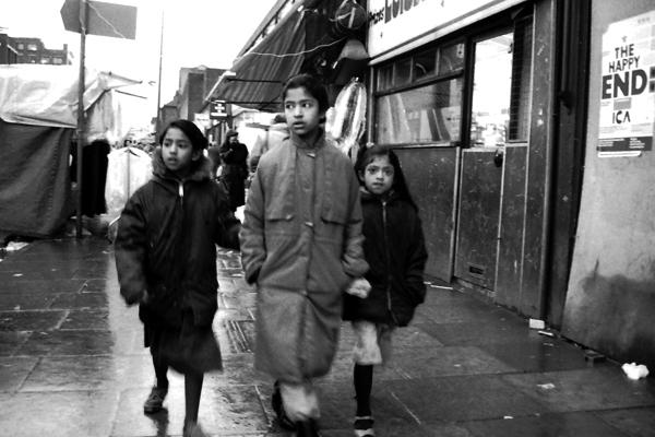 On the street in the rain, Whitechapel c. 1982
