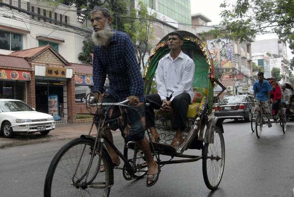 Rickshaw with passenger, Dhaka 2008