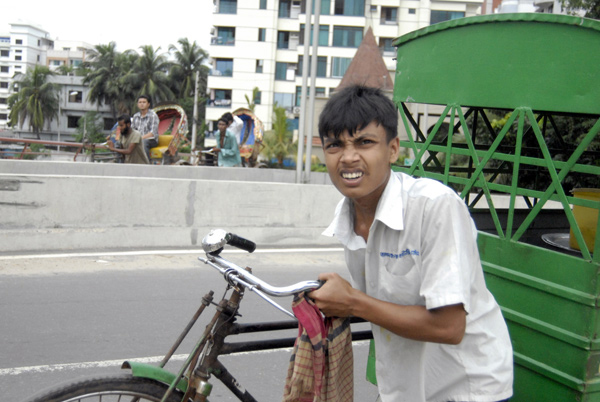 Cyclist with carriage attached, Dhaka 2009