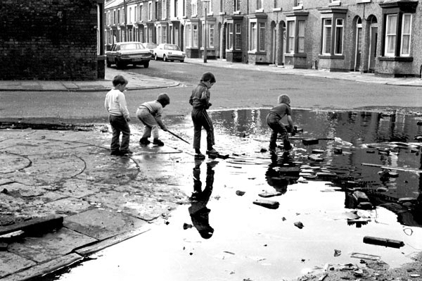 Children playing in puddles. Liverpool 8, 1982