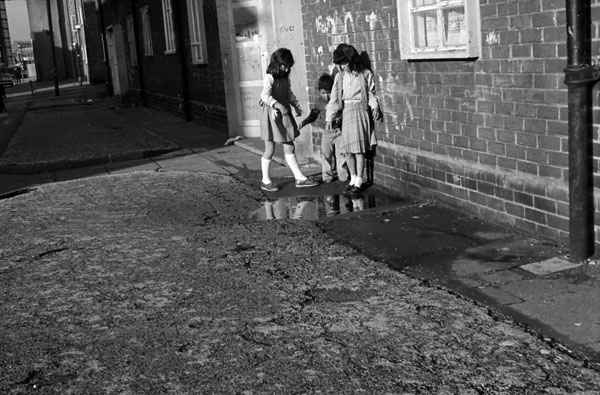 Children playing in a puddle, Liverpool 8, c.1980