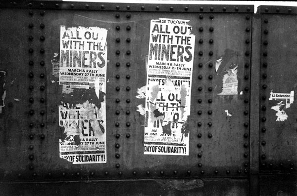 Posters supporting the miners. Brick Lane Bridge 1984