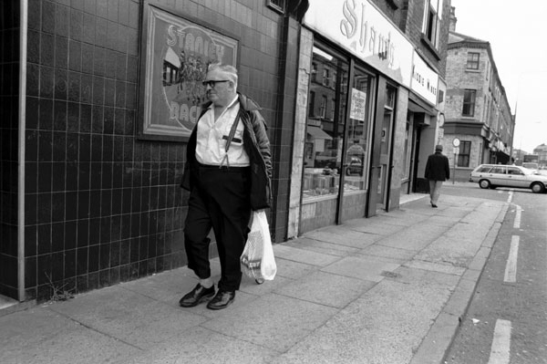 Man with a plastic bag, Liverpool c. 1982