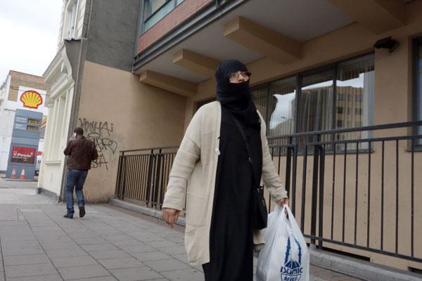 Woman with a plastic bag, Whitechapel 2013