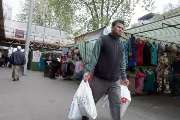 Man with plastic bags, Whitechapel 2013