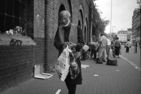 Man with plastic bags, Bishopsgate Goods Yard, c. 2001