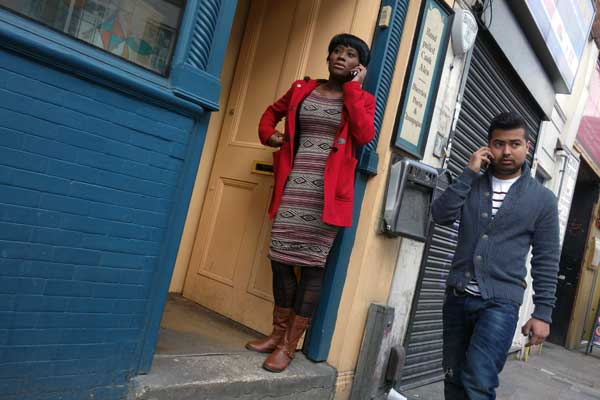 Two people on mobile phones, Osbourne Street 2013